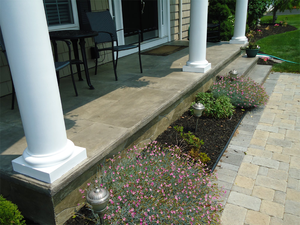 Front porches with stone concrete overlay solutions for Allure cement siding